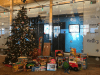 Toys for Tots Donations adorning the Boston office before delivery